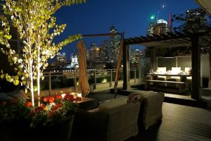outdoor seating area, plush chairs under night skyline