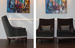 college of black armchairs, decorative striped black/white pillows, under colorful wall art