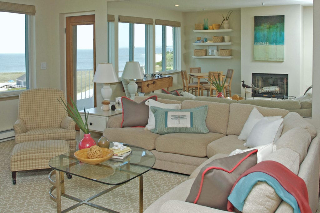 Living room with sectional and ocean view