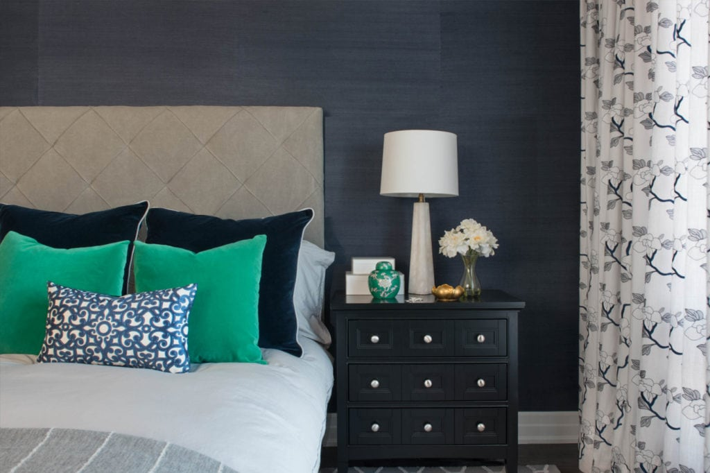 modern bedroom with pretty night table and alabaster lamp