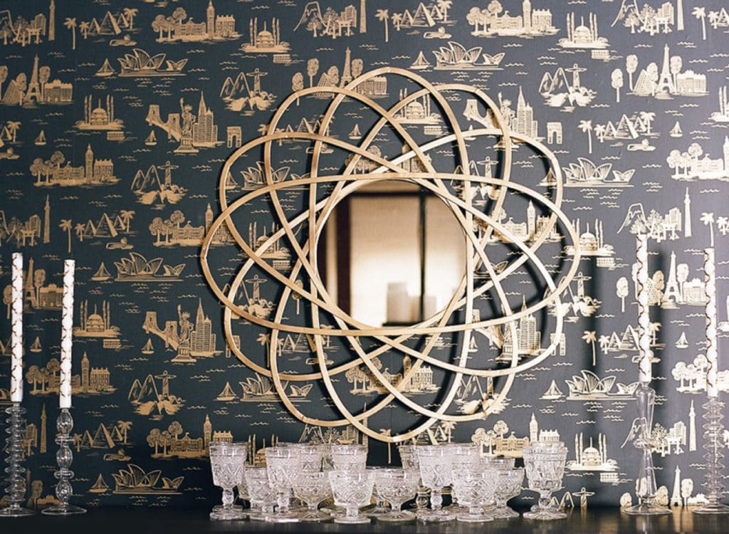 abstract art with mirror, navy wallpaper with gold designs, glass decor
