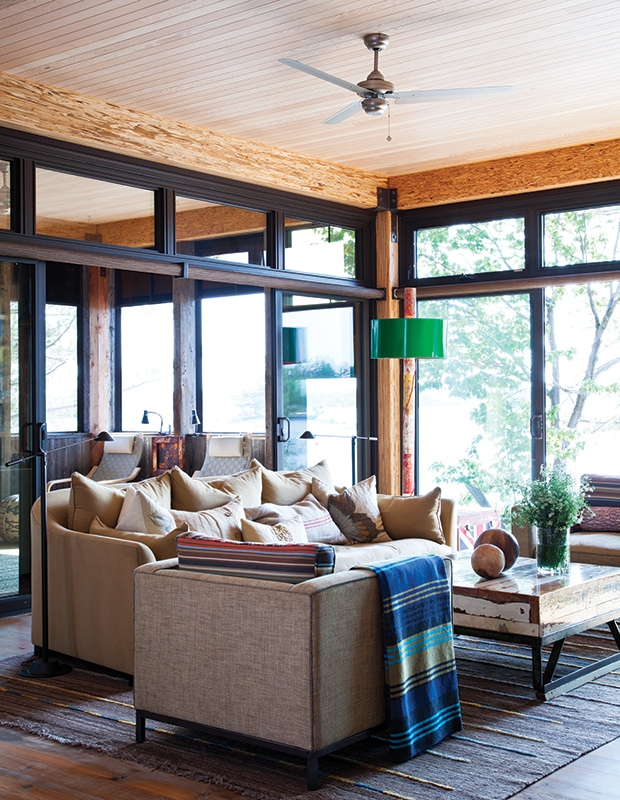 rustic living room, tan couches, blue throw blanket