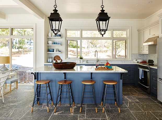 modern kitchen, blue island and countertops, bar stools, lantern light fixtures