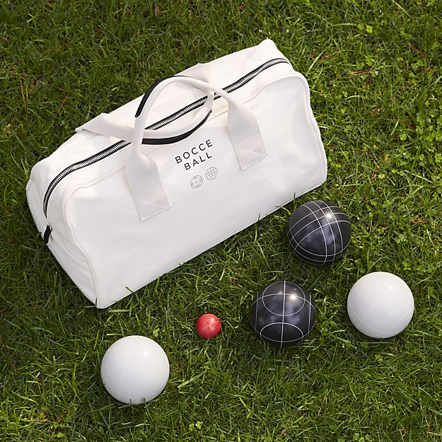 bocce ball set on grass with case