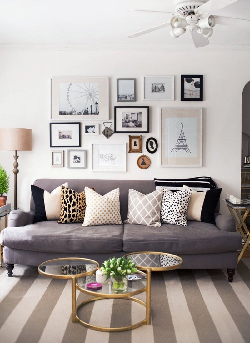 gray couch, decorative pillows, wall art