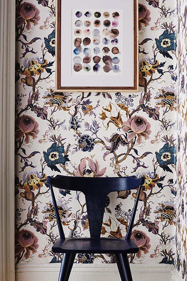 black chair, floral patterned wallpaper, wall art