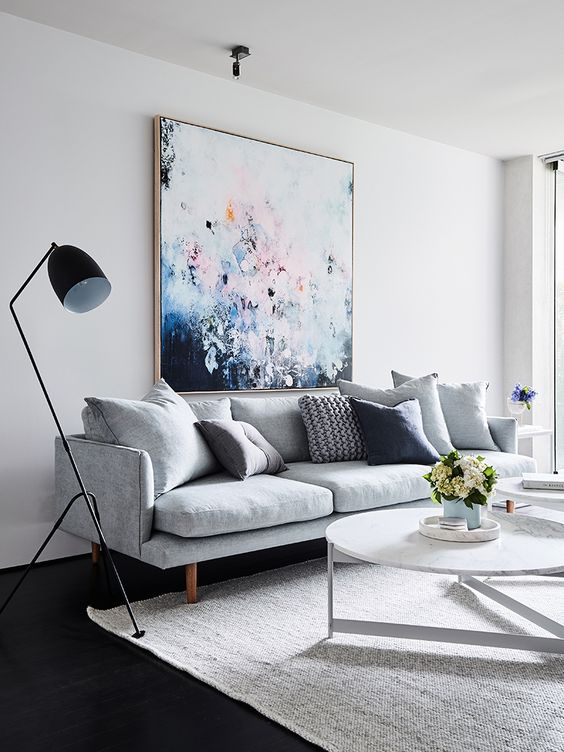 modern white living space, colorful wall art