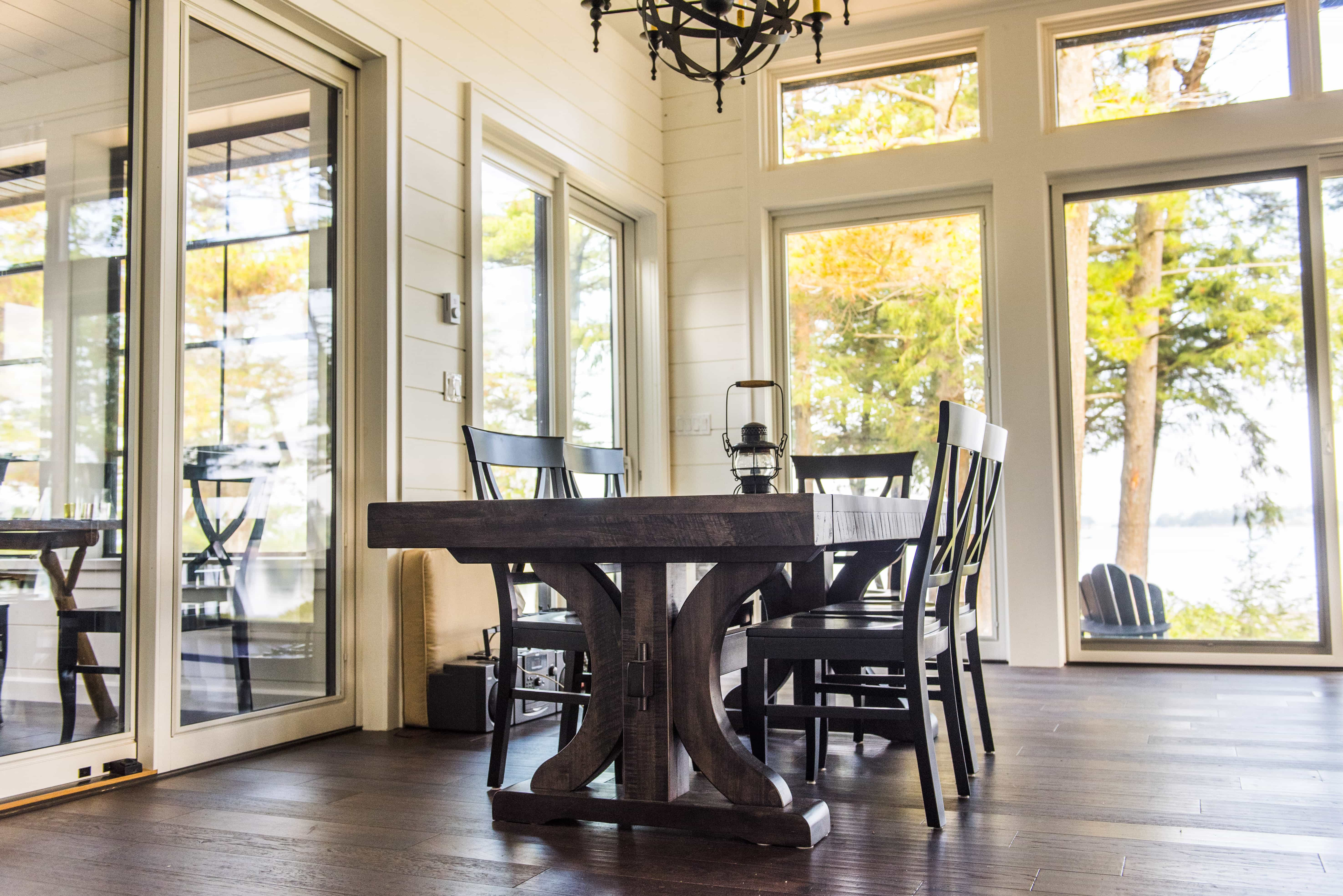modern/rustic dining area with large windows