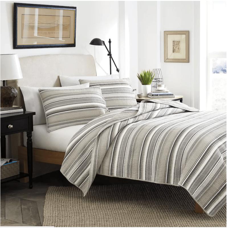 white bedroom, striped pattern bedspread