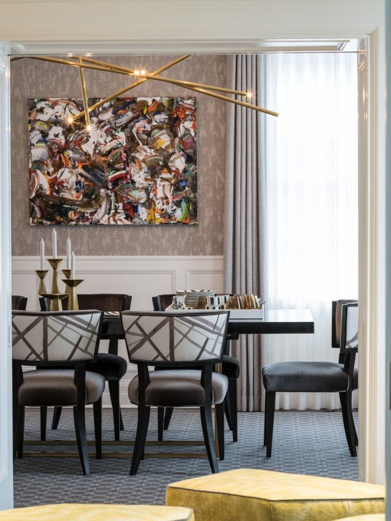 dining room, gray chairs, colorful wall art