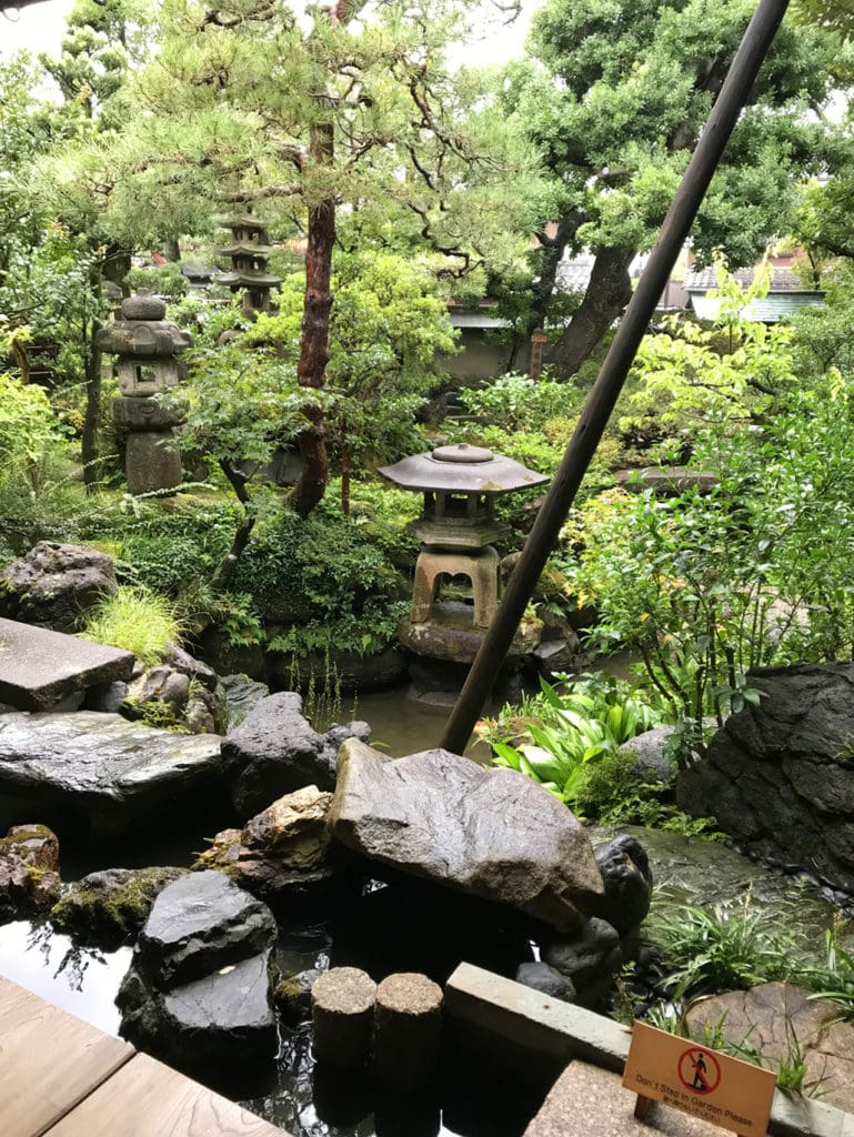 Japanese garden with water feature and small pagoda