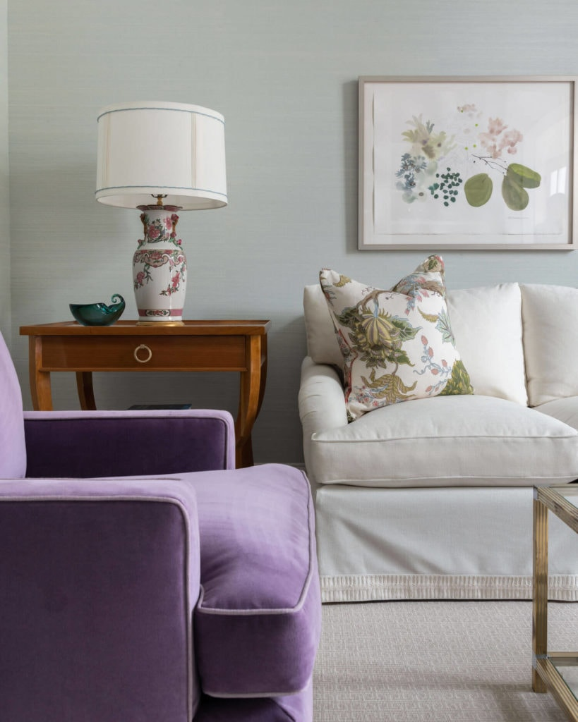 living room vignette with white sofa and violet chair