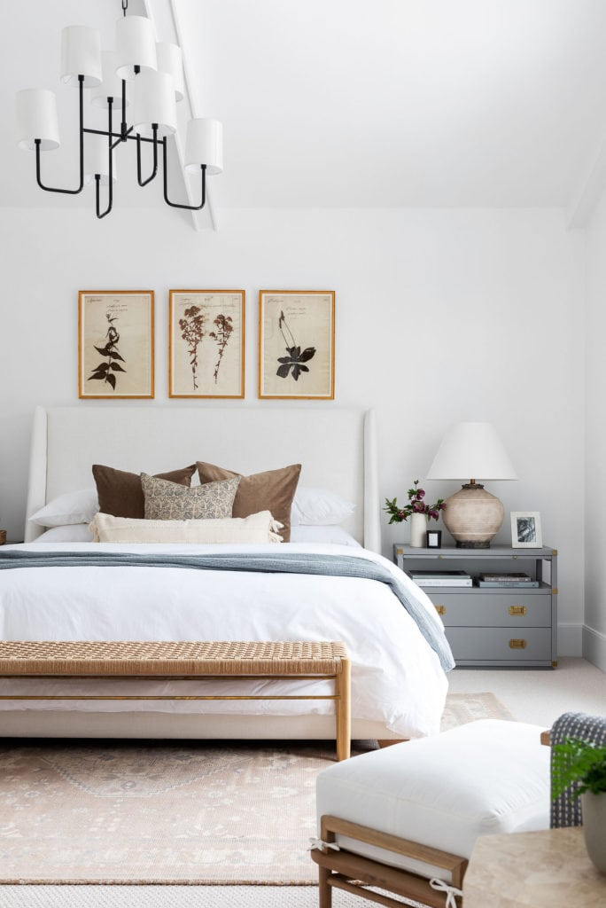 bright white bedroom with blue-gray and natural rattan accents