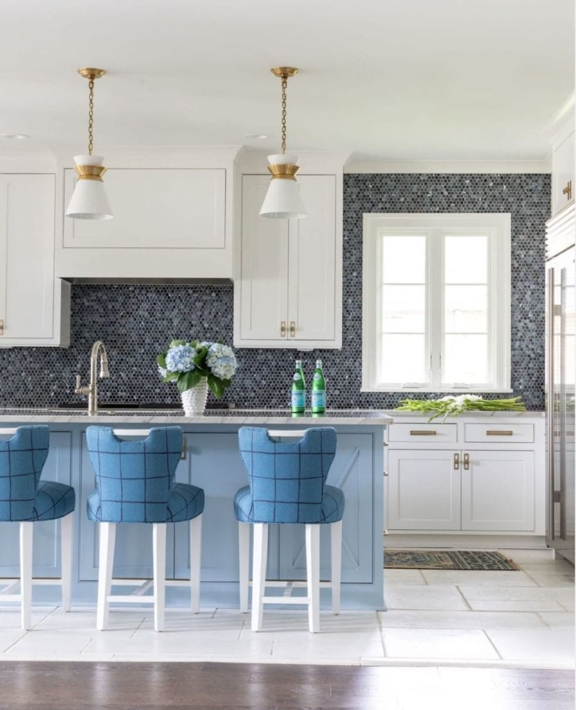 blue and white kitchen with pretty backsplash and blue and black check chairs