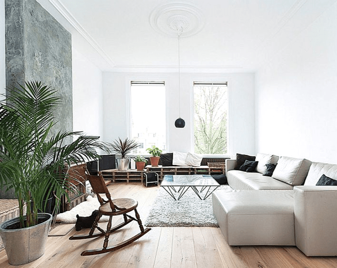 living room with white sectional and modern furniture