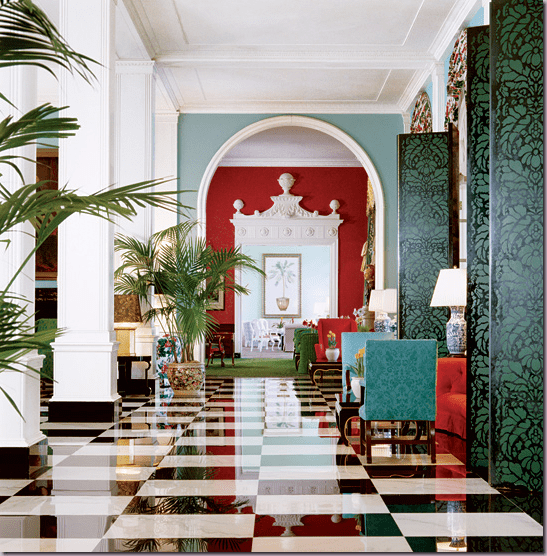 Gorgeous elegant hotel lobby with black and white marble floors, teal and red accents