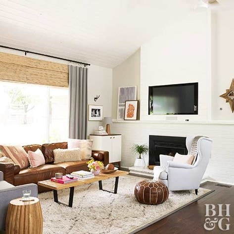 living room with cognac leather sofa and white walls