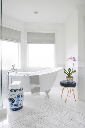white bathroom with white tub