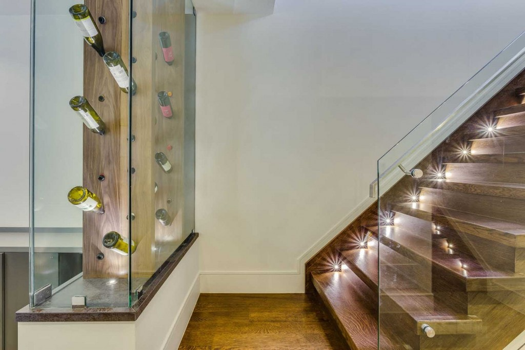 Hardwood stairs with tiny lights highlighting the treads with a pretty pattern of light