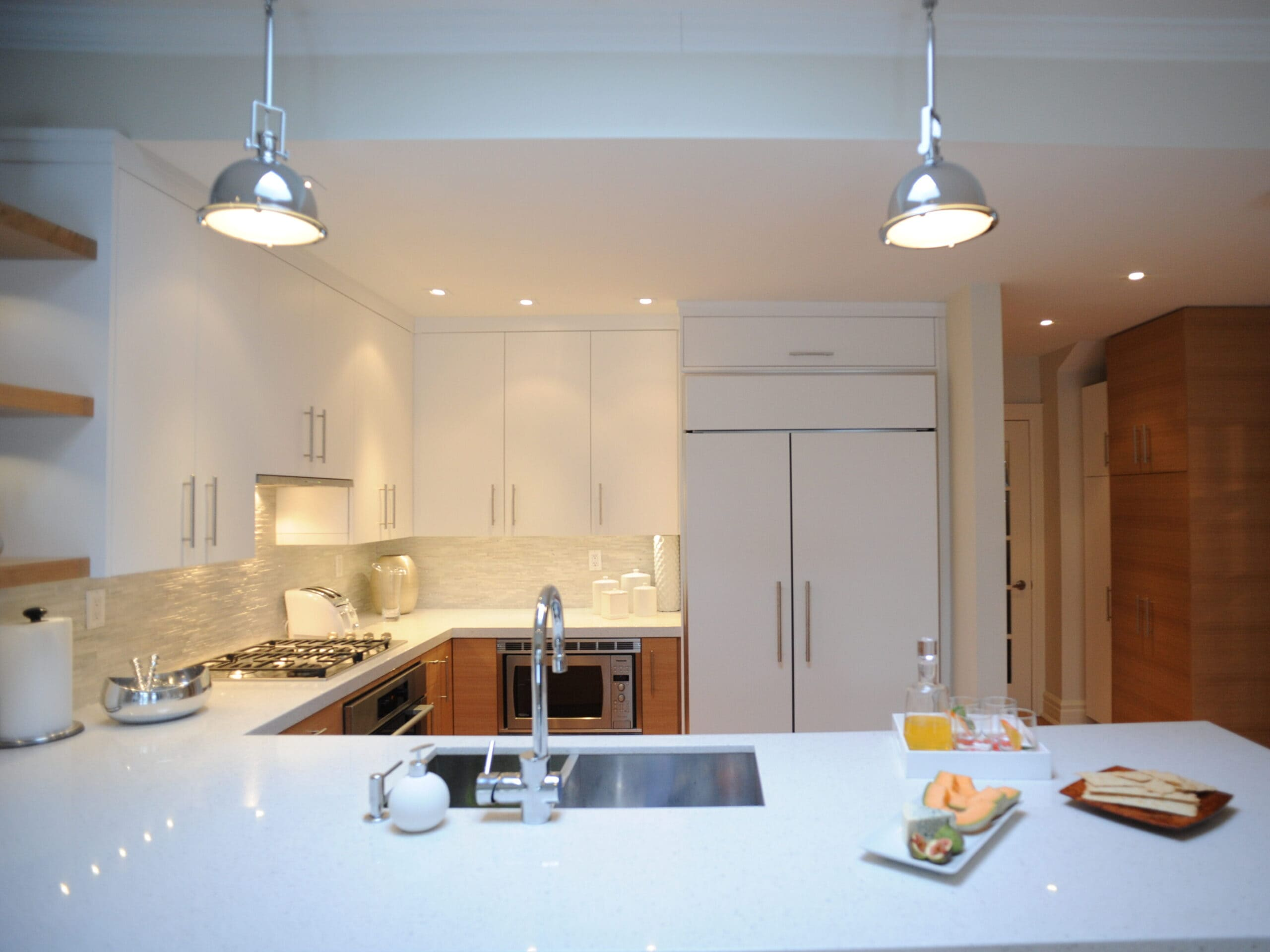 modern kitchen with white cabinets and light oak lowers