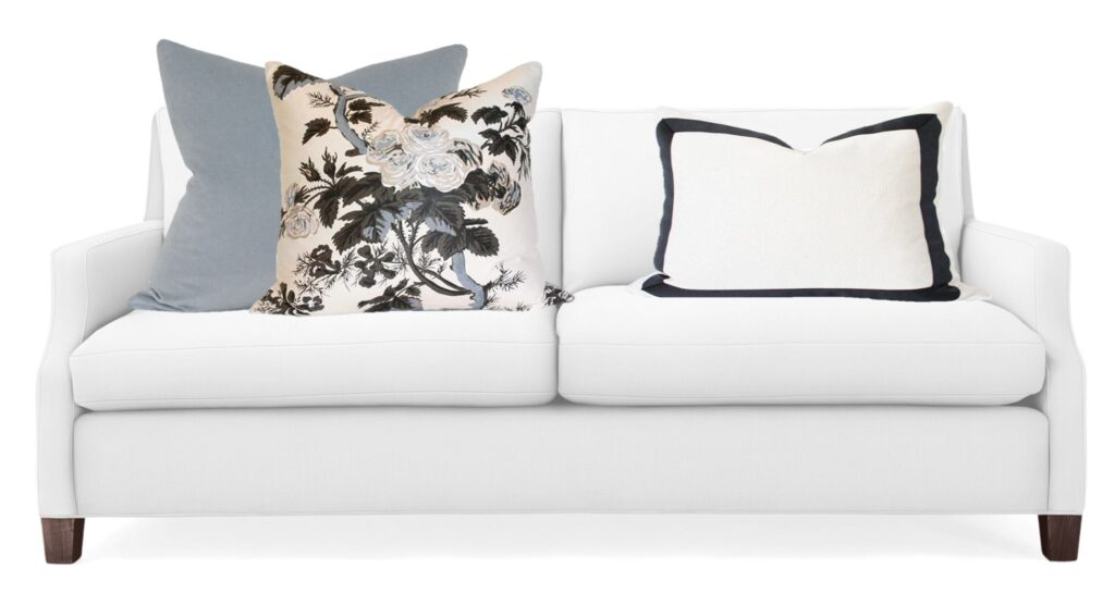 white  love seat with three pillows