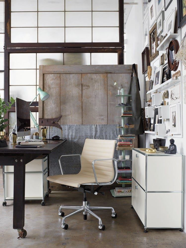 industrial office space featuring a cream leather desk chair
