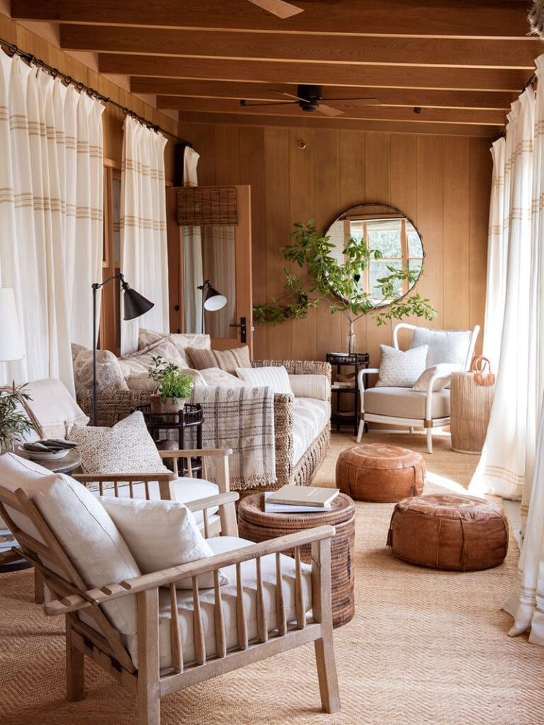 image of windowed porch with gauzy drapes and natural materials in colour scheme