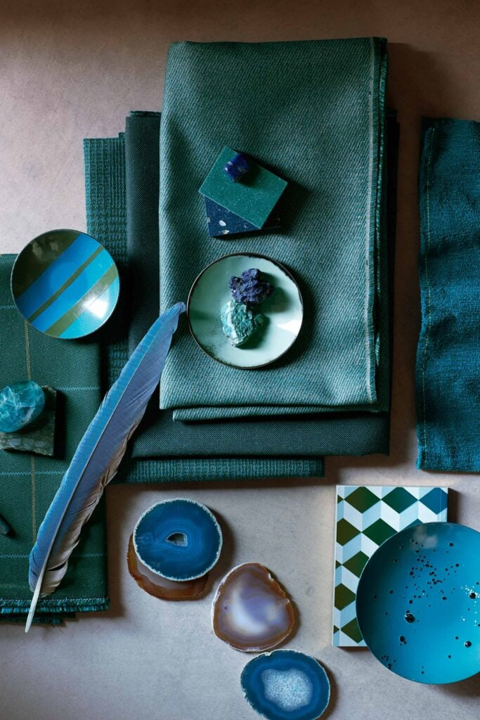 flatlay of teal fabrics and decor pieces