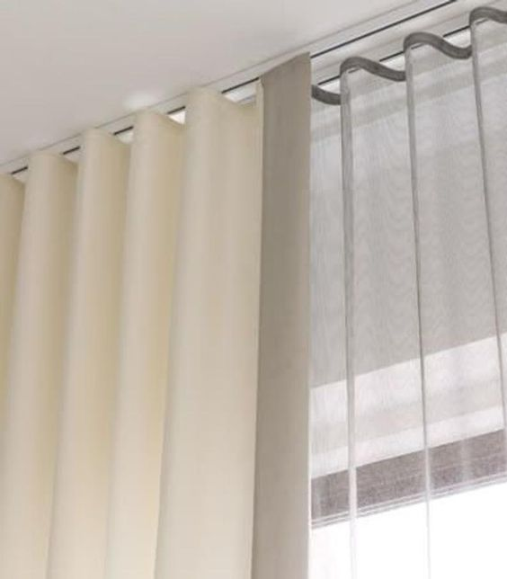 example of ecru ripplefold drapery mounted in a channel on the ceiling