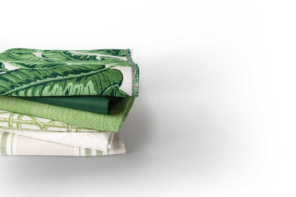 stack of folded green fabrics