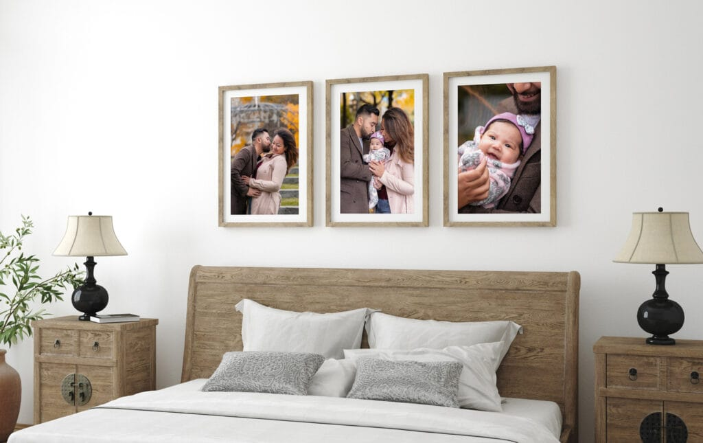 Bedroom with rustic wood furniture and a display of 3 framed family photos over the bed