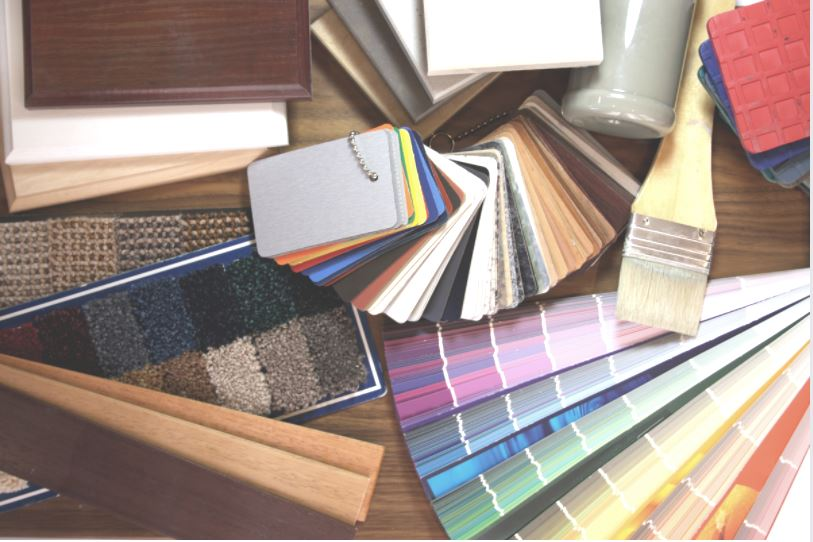 Selection of samples: carpet, paint swatches, wood blinds, laminate countertop material.