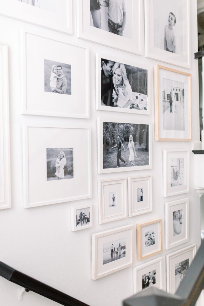 Stairway gallery with black and white family photos