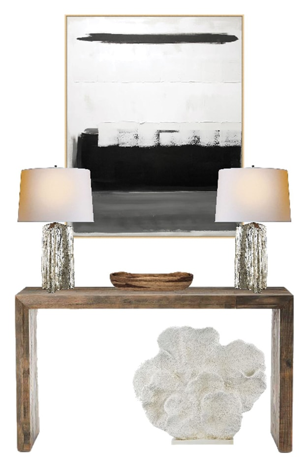 vignette of a console table, two lamps, black and white abstract painting