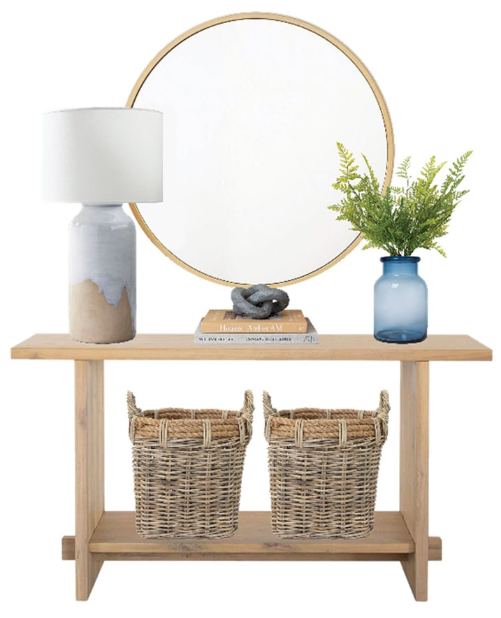 vignette of console with mirror, lamp and vase