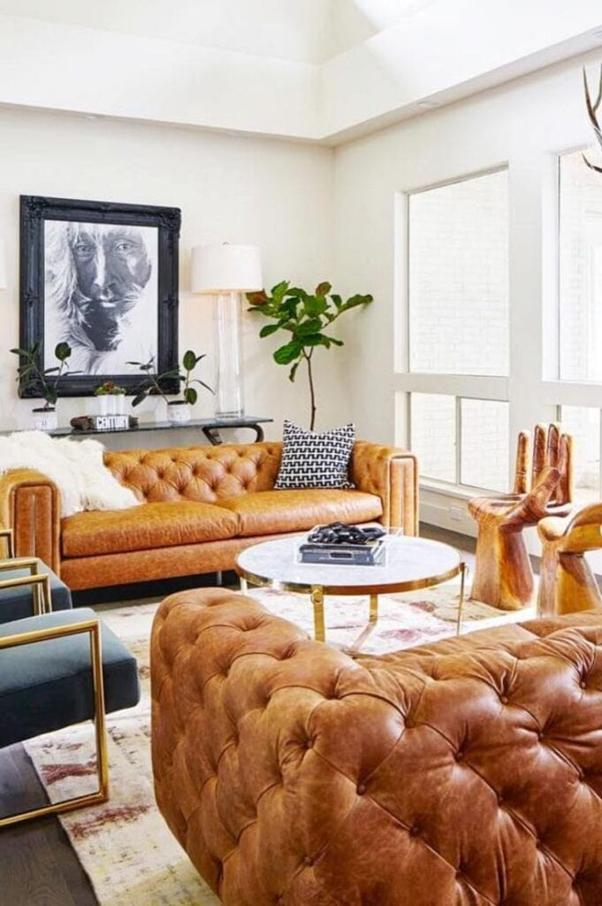 cognac diamond tufted leather sofas in a living room setting