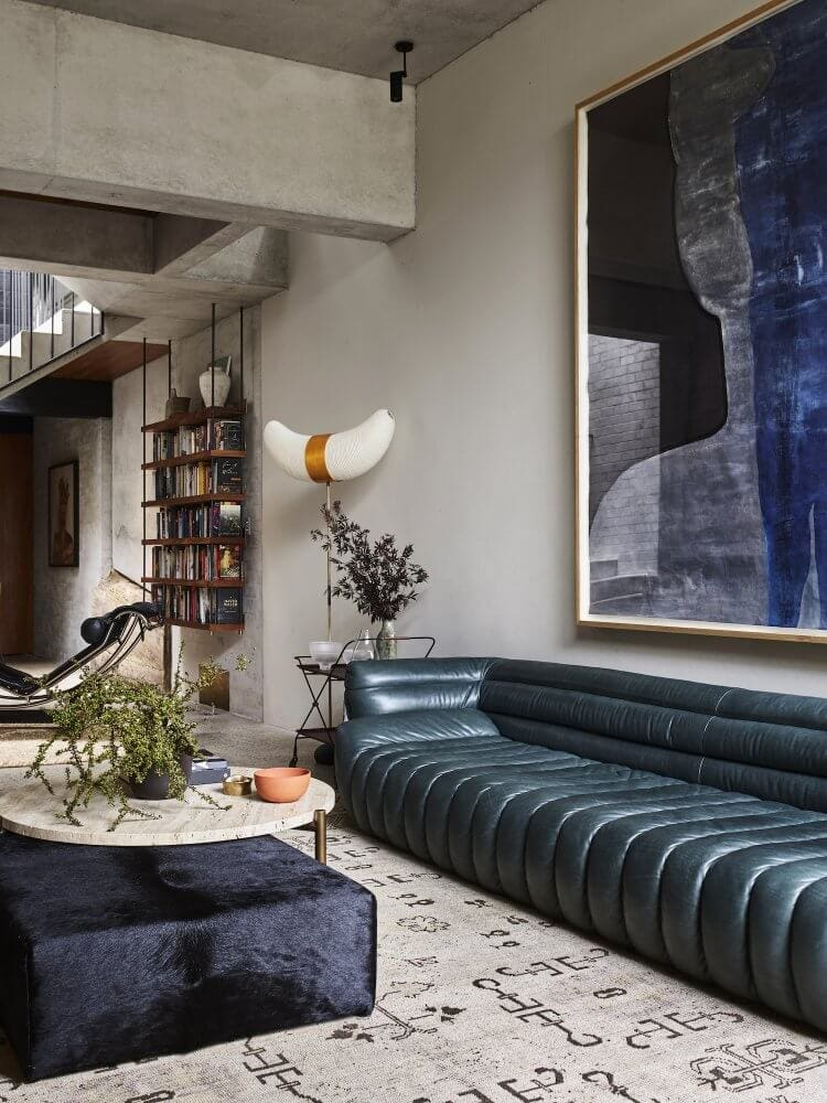 channeled leather sofa under oversized contamporary artwork