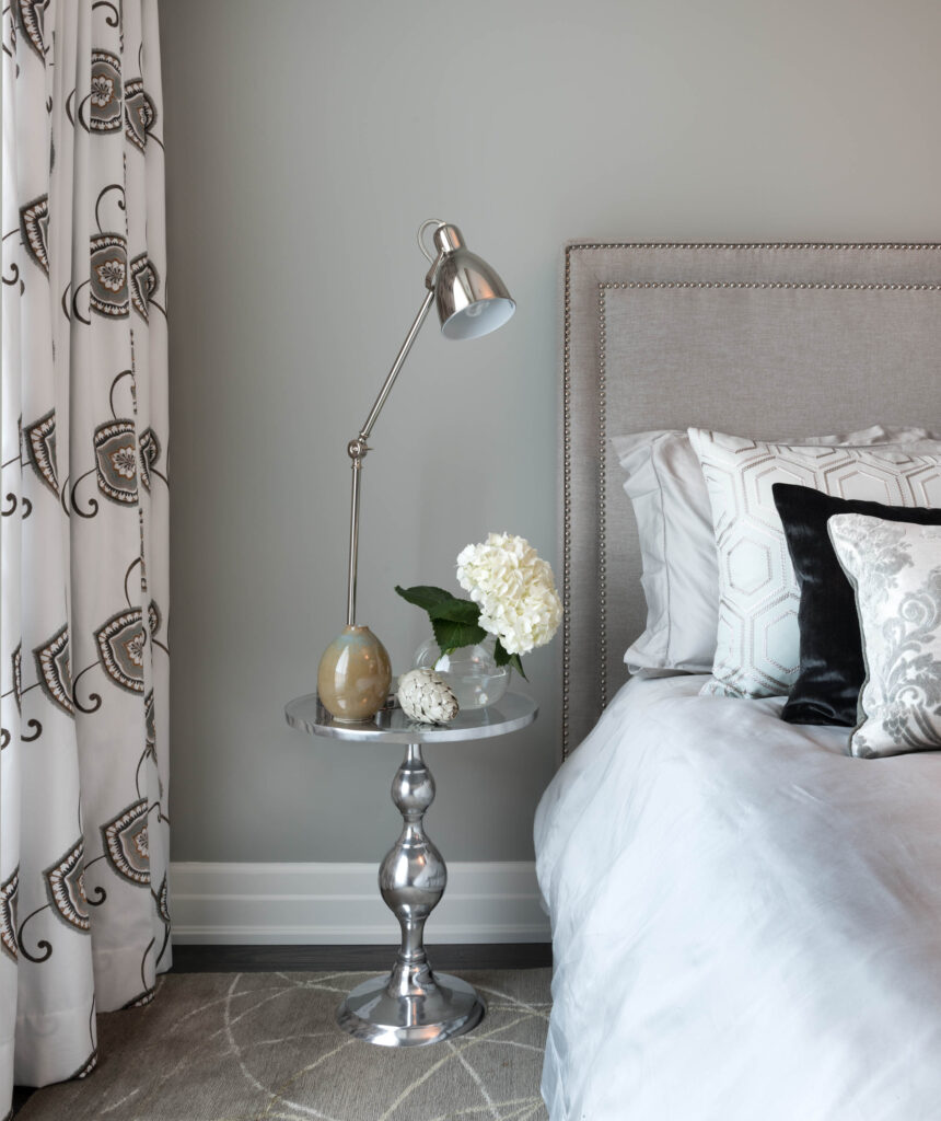 bedside table with lamp and styling items