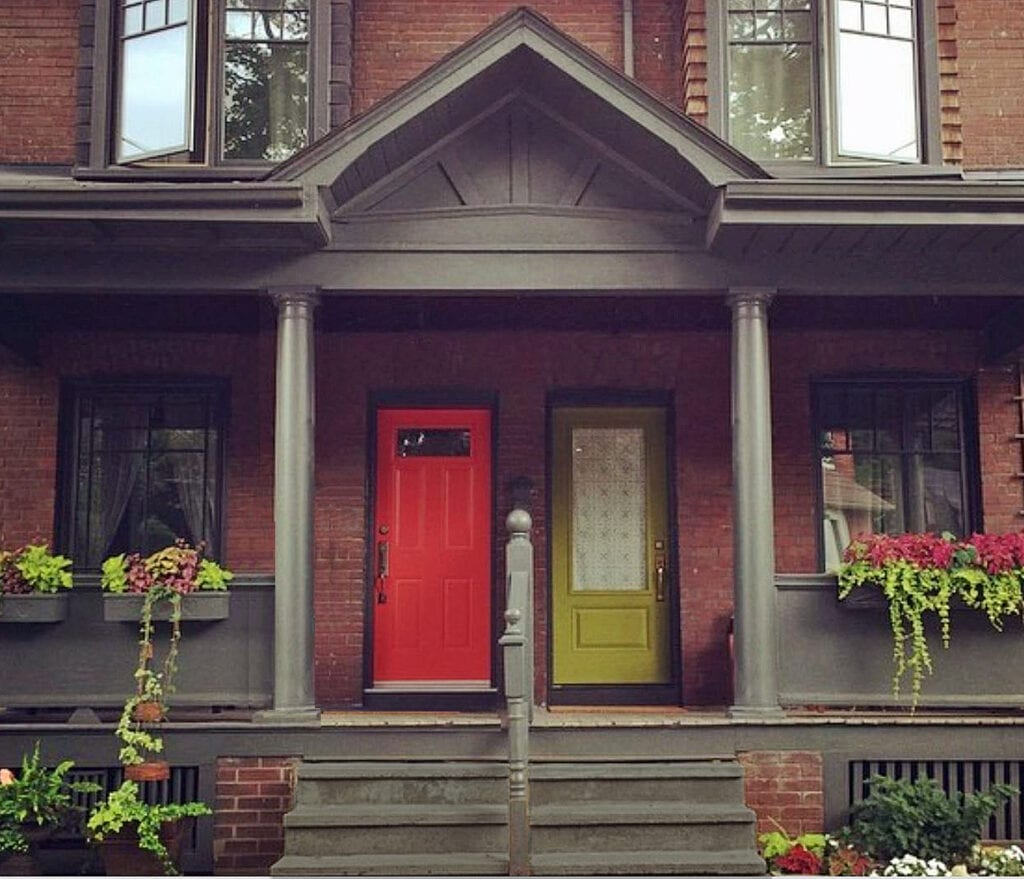 Duplex showing complementary front doors colur in Toronto's Beaches and Leslieville neighborhood