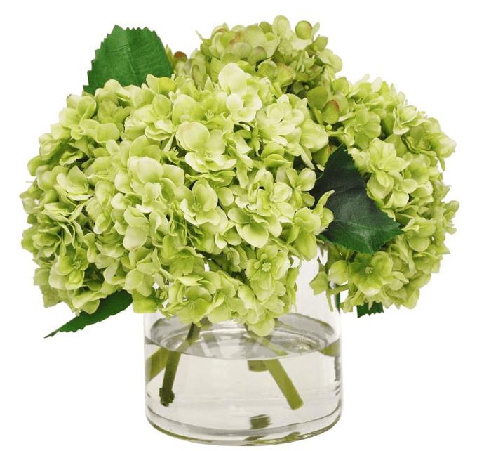 faux green hydrangea in glass vase