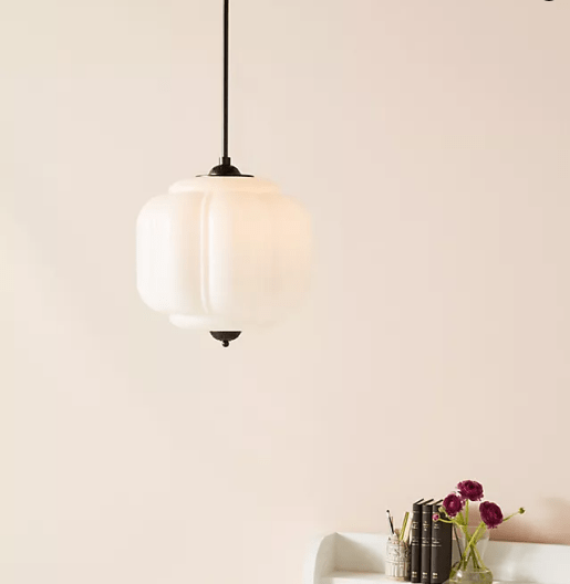 pendant light with milk glass and a brass base