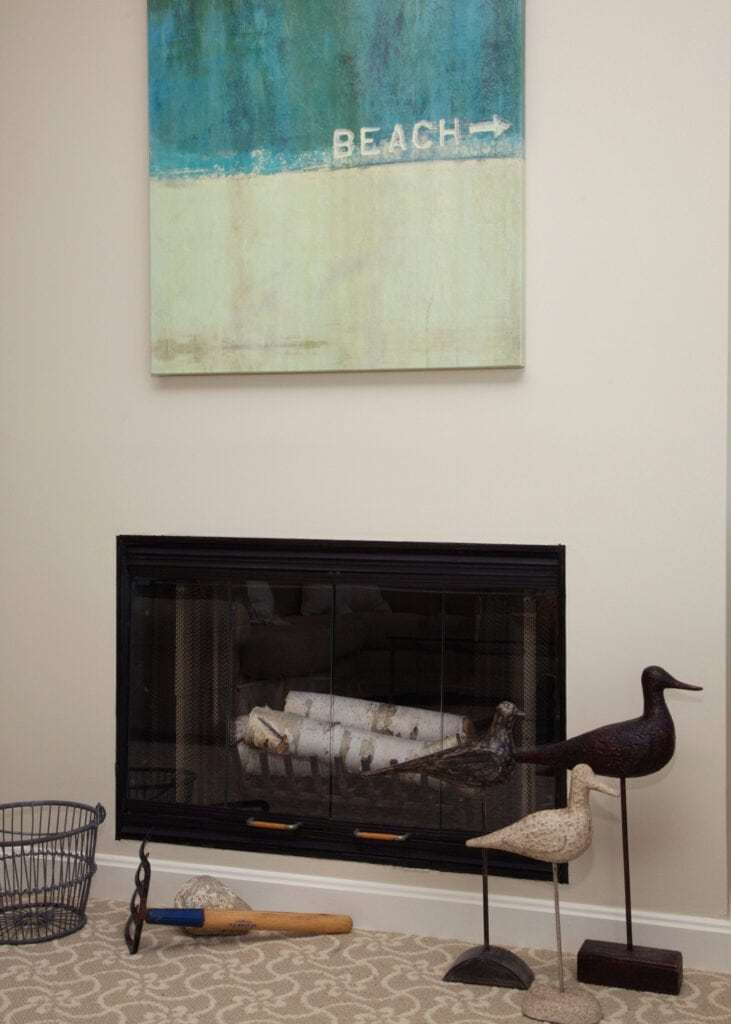 modern fireplace with ocean themed art and accents