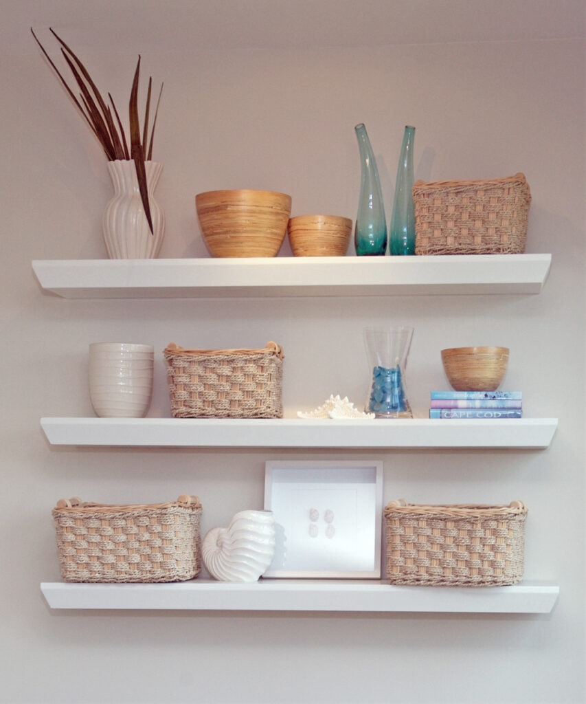 bookshelves styled with baskets and shells