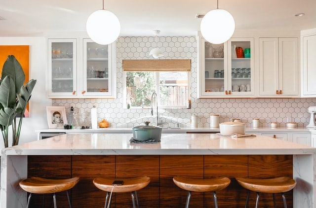 cozy white kitchen with warm wood accents